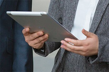 Lawyer holding an ipad reading an article